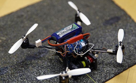 Small drones can open doors and carry large loads.
