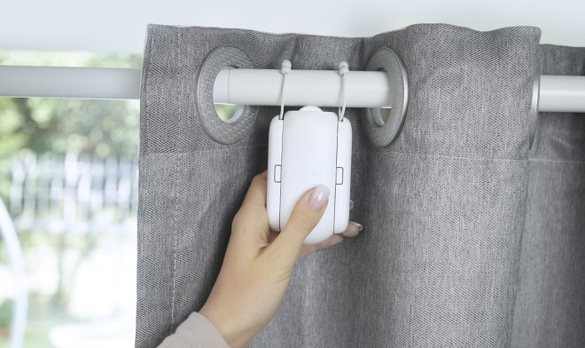 A small SwitchBot Curtain gadget will turn ordinary curtains into an element of a smart home
